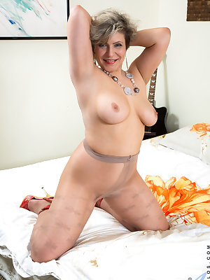 Cock craving grandma Angel Baby is a lusty cougar with no shame in seducing her thick body. Slipping her hand down her sheer thigh highs to rub down her landing strip cunt isn't enough to satisfy this needy pussy, so she turns to a big dildo that finally