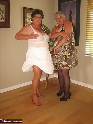Two, very sexy MILFS in Girdles. See us bear it all for you baby...xo