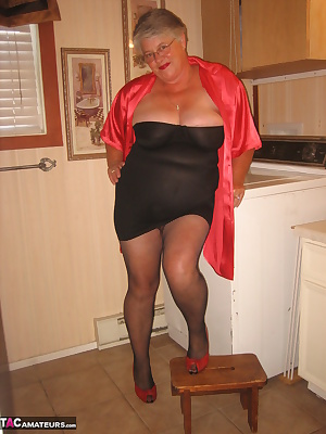 Hot Mama, in the laundry room, wearing  pantyhose, and a black shaper. Don't you just want to bend me over that washer,