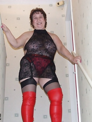 Red thigh boots and black stockings, don't get much more sexy than this eh guys xxx