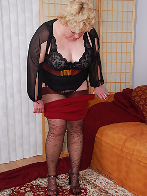 I sure like the lacy design on these brown stockings plus the dark red tops complement  my little skirt... To complete m