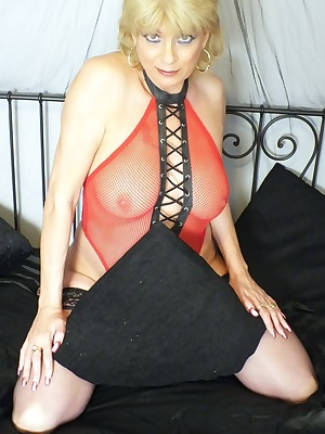 Sexy photos of me on on my play bed with red fishnet outfit on with nothing underneath.