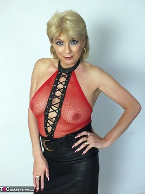 Dressed in Red fishnet top with no bra so my nipples press hard against the see through material also in stockings and a