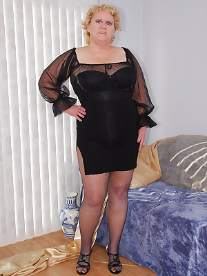 How do you like my sheer black flouncy top... Since it is so sheer and I like to be a tease, I wear a classy black busti