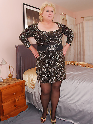 Mmm, I like the feel of nylons and garters on top of pantyhose. Today I don sheer black panties underneath, to be an ext