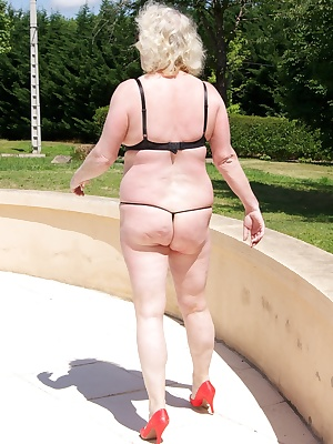 Hi Guys, another set from last years trip to France, posing by the pool in my quarter cup leopard print Bra and skimpy K