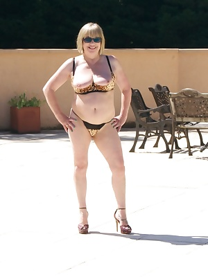 Hi Guys Here I Am Posing Poolside in my Leopard Print quarter Cup Bra and Skimpy Thong, it was a really Beautiful day, N