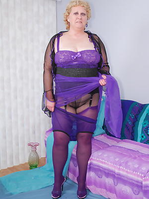 Mmm, I like how this nylon gown is so sheer don't you.  Just the thing to wear with matching purple nylon panties and mu