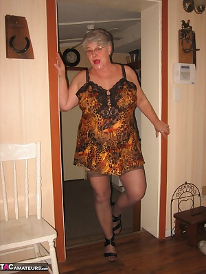Leopard print lingerie and one HOT MILF loves to take it off for your erotic pleasure.
