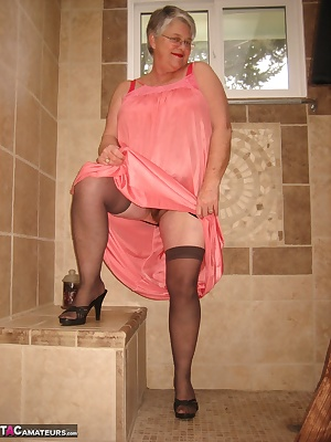Girdlegoddess getting ready for a steamy hot shower.All natural and sexy HOT.