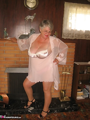 Sexy Girdlegoddess in a pretty outfit, standing by the fireplace.In my pantyhose and a hairy pussy showing through.