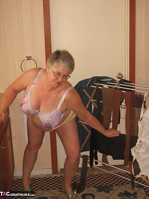 Girdlegoddess is washing her delicate stockings,  bras and panties by hand using the scrub board. I think i better wash