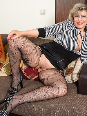 Thick granny Angel Baby is a 49 year old Russian cougar with a sex drive that won't quit. After taking off her demure daytime clothes, you can admire this lusty aging woman's hanging tits and landing strip pussy in a sheer bodysuit before she peels off ev