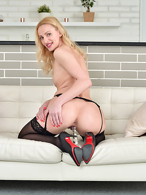 Toys are Affina Kisser's best friend, and this 35 year old Russian mom is happy to show you just how she likes to play. Peeling off her clothes is the first step towards total pleasure, followed closely by pressing a dildo deep into the cum hungry depths