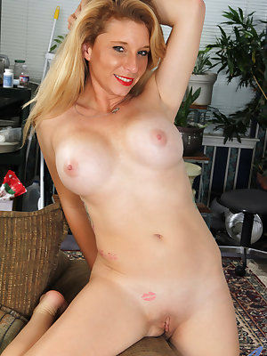 If you're looking for a fun, flirty tease, then look no further than Jasper Shelton, an American mom with a huge set of enhanced boobs. This horny housewife is always up for a good time, and she proves it by peeling off her miniskirt and panties to let al