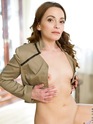Russian bombshell Alika S. likes to keep in shape with a pole dancing routine, but strutting her stuff always gets this mom horny. She'll strip slowly, showing off her moves and her soft bare twat and small tender all naturals as she works her way out of