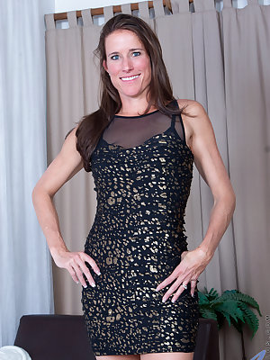 American mom Sofie Marie wants you to admire her sexy skinny body, so she peels off her miniskirt dress and then slips her bra and thong off with a flirty smile. This horny housewife can't keep her hands away from her bare cunt, only stopping to grab a vi