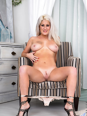 Gorgeous curves are the first thing you'll notice about British hottie Lu Elissa, especially the way her miniskirt rides up. Once she has pulled out her huge breasts with diamond hard nipples and peeled off her panties, though, her landing strip pussy and