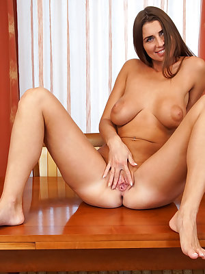 Youa??ll be fortunate indeed to lay eyes on Liya Lucky, a busty Russian milf with tits that a bra can barely contain and an ass that looks amazing in a thong. This cum craving housewife cana??t keep her hands off her generous assets, especially her bare t