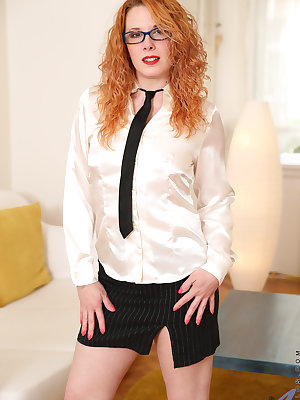Slipping out of her glasses and uniform after a long day of work are just what Czech housewife Monita needs to relax. Since she's naked anyway, it makes sense to rub her hands over her small natural tits and down to her juicy ass, and then go to town on h