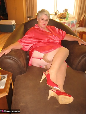 Mmmmmm Smoking hot in my red satin, red garter and stockings, relaxing having a cig. This ones for your smoking fetish m