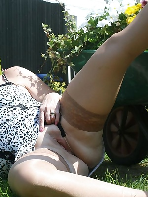 Showing off some lovely silky hold-ups and cfm shoes in the sunshine.
