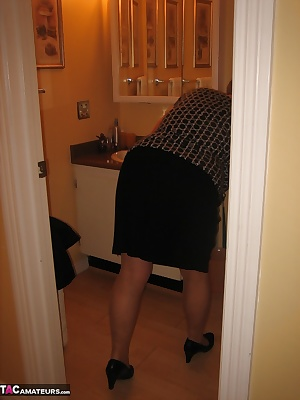 Just getting home, and boy do i have to pee... see Girdlegoddess on the toilet and then.... getting out of her work clot