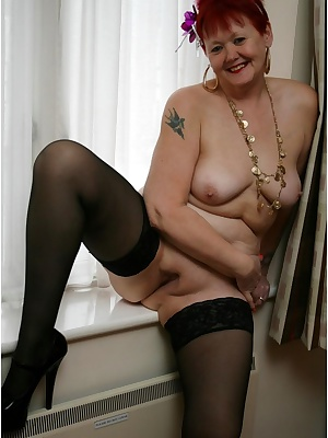 Showing off on the windowsill, with my sexy black hold-ups on.
