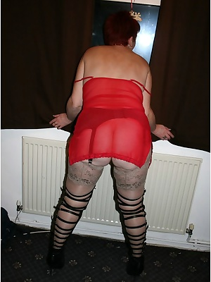 First pics of 2009, taken on New Year's eve in fact. Black thigh boots, stockings, and some sexy red lingerie.