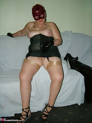 Full length black corset and stockings, and a little red feather mask to top it all off.