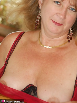 Devlynns gets blazing hot with sheer red lingerie. Peek in on her as she peeks through the rail.