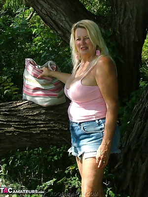 Playing in the woods - barefooted wearing daisy dukes and a spaghetti strap top - see the boobs pop out.