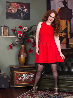 After an evening date, 31 year old Annie M. comes home to take care of her needs. The redhead housewife slips out of her flirty dress, bra, and panties. Her hands caress her medium all naturals and then slip lower to tease her hairy cunt until it is dripp