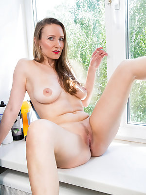 Get ready for 38 year old Solena who looks good enough to eat in a miniskirt evening gown. Peeling off her bra and panties, she feels up her bigtit boobs and presses her talented fingers into the slippery delight of her juice filled landing strip fuck hol