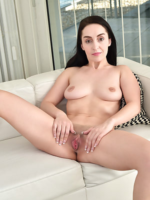 Lusty mom Di Devi is short sweet and horny! Her full hanging boobs love to be squeezed and her ass is certified awesome in a thong. Check her out as she strips down to her high heels and then parts her thighs to spread her nicely trimmed twat just for you