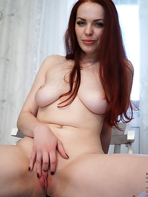 Sheer white lace lingerie hugs Alice Wonderland's lush curves as the redheaded mom caresses her hanging boobs and pinches her diamond hard nipples. Her clothes slip to the ground, leaving her hands free to plunge her fingers knuckle deep into her tight we