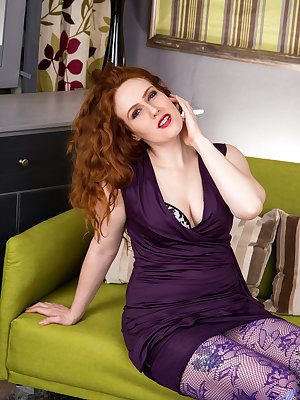Wearing an evening gown and stockings, Annie M. is a hot mommy. This mature milf is insatiable, so it's no surprise when she slips out of her dress to fondle her floppy boobs. When she pulls her thong aside to reveal her all natural red haired pussy, it's
