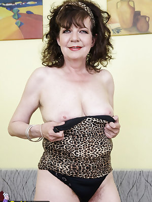 Old granny possessing extremely hairy pussy wearing sexy underwear
