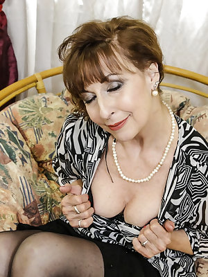 Hot old mature woman is masturbating her pussy alone acting very seductively