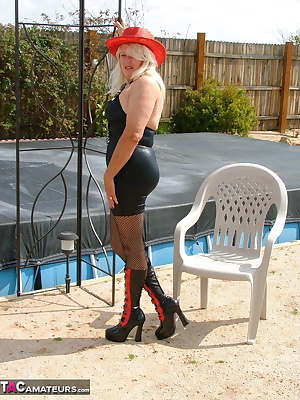 A red hat and some great knee boots with a basic black dress and some crotchless mesh pantyhose, it's one hot grandma th
