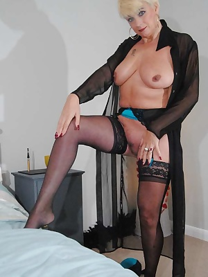 Dimonty in her black negligee black and blue lingerie flashing her tits and trimmed pussy