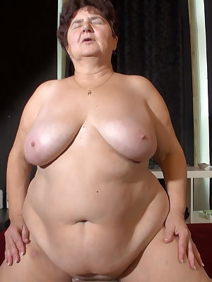 This brunette granny can ride and sock his cock and enjoys every part of it.