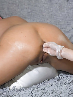 Fisting and masturbating pussies from two horny lesbians