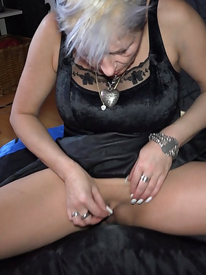 Sexy granny plays with piercing first and done masturbates her pussy