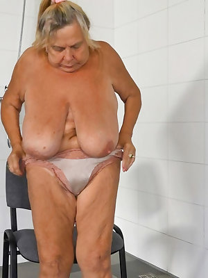 BBW Big tits granny is masturbating pussy in the shower
