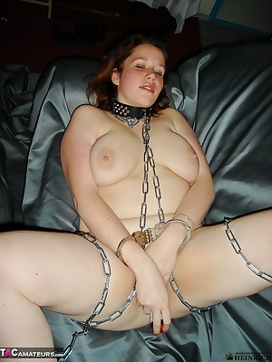 Amateur snapshot pictures of voluptuous big tits redhead Jessica masturbating with her big vibrator while chained and ha