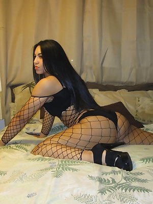 Ching likes to stretch on her bed with her black fish nets. Just waiting for you to cum on in.