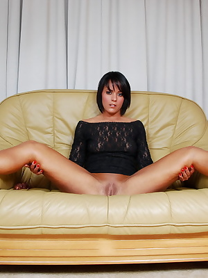 Scarlett Hope, sitting in the livingroom dressed in a much to short see-through black dress and high heel shoes. Scarlet
