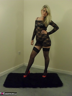 One of my favourite collections. My black fishnet body stocking, black stockings and shiny red heels. This shows my domi
