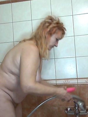 Horny mature women in need of her toy while having shower